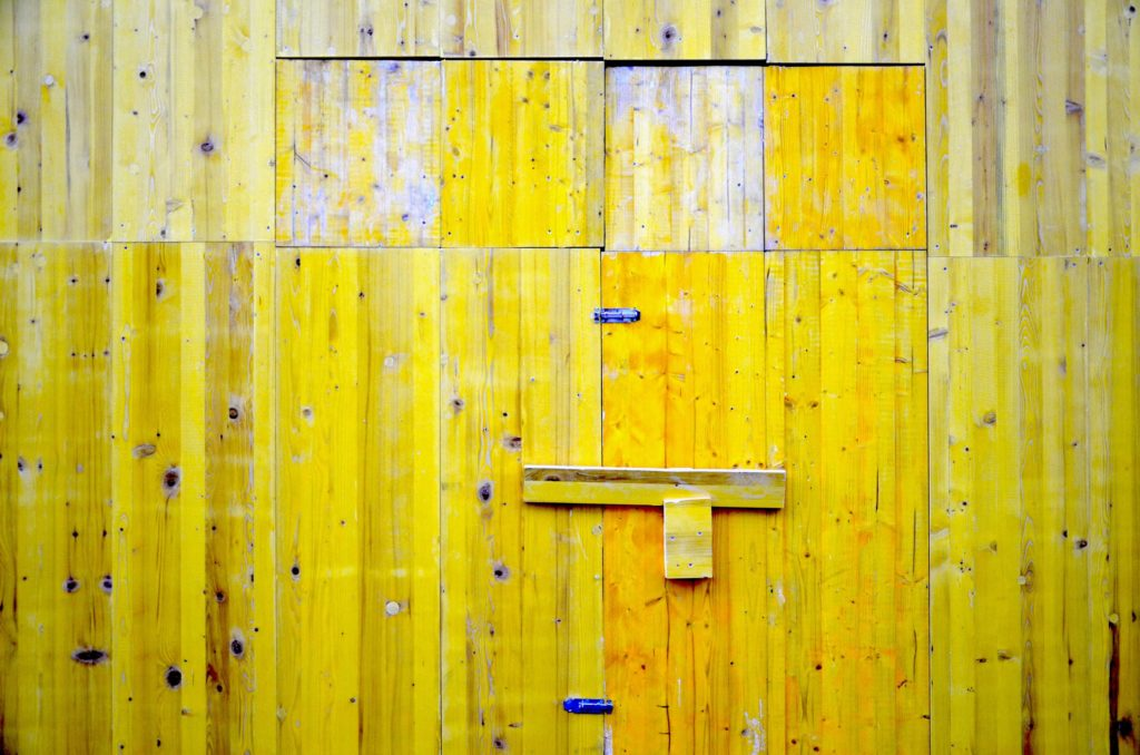 Photo of a yellow wooden wall.
